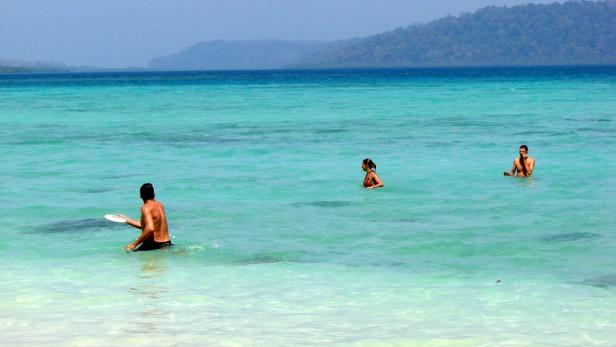 Enjoying a game of frisbee at Beach No. 3, Havelock Island, Andamans, India